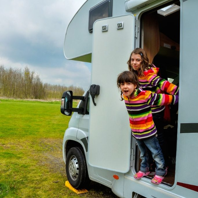 kids-in-camper-family-travel-in-motorhome-on-vacation-picture-id858180640